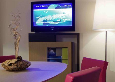 Hotelzimmer mit Animationsprogramm im Novotel Wien City