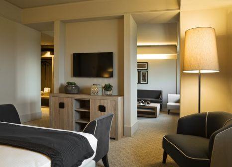 Hotelzimmer mit Mountainbike im A.Roma Lifestyle Hotel