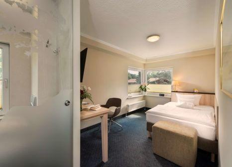 Hotelzimmer mit Mountainbike im Best Western Plus Ostseehotel Waldschlösschen