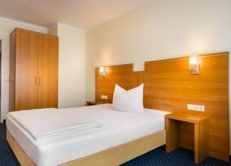 Hotelzimmer mit Animationsprogramm im acora Hotel und Wohnen Bochum