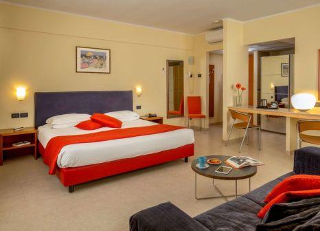 Hotelzimmer mit Mountainbike im Best Western Blu Hotel