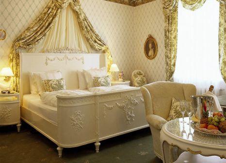 Hotelzimmer mit Hochstuhl im Hotel Der Kleine Prinz
