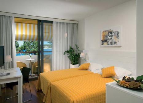 Hotelzimmer mit Mountainbike im Island Hotel Istra