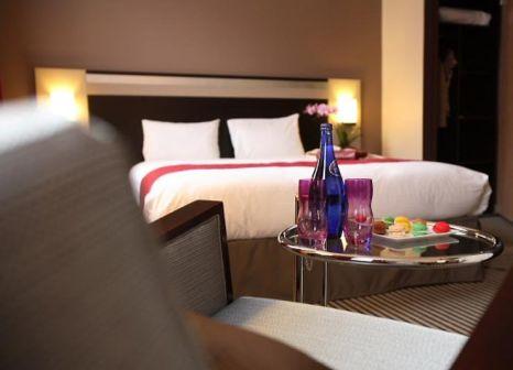 Hotelzimmer mit Hochstuhl im Holiday Inn Paris - Porte de Clichy