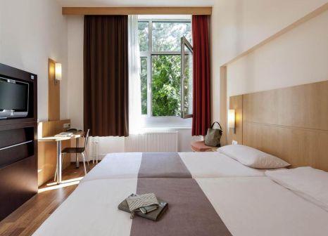 Hotelzimmer mit Animationsprogramm im ibis Berlin Neukoelln Hotel