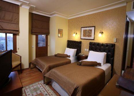 Hotelzimmer mit Hochstuhl im Yusuf Pasa Konagi