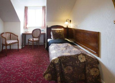 Hotelzimmer mit Hochstuhl im Milling Hotel Windsor