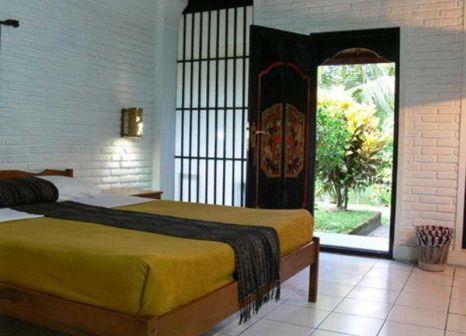 Hotelzimmer mit Sandstrand im Puri Kelapa Garden Cottage