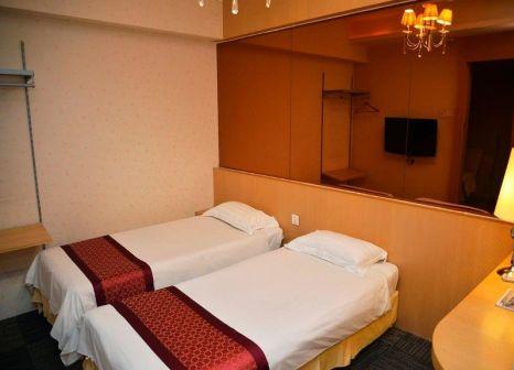 Hotelzimmer mit Klimaanlage im The Crown Borneo
