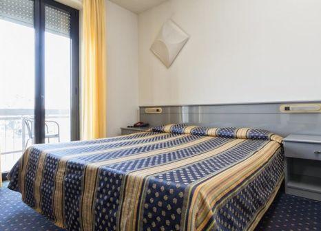 Hotelzimmer mit Mountainbike im Hotel Il Melograno