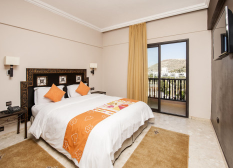 Hotelzimmer mit Mountainbike im Hotel Oasis