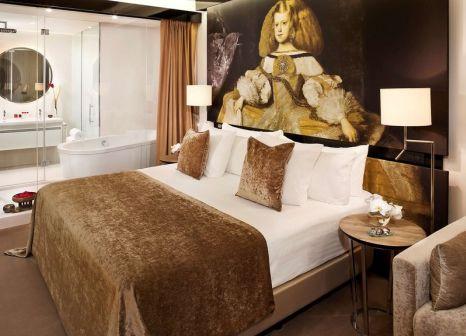 Hotelzimmer mit Mountainbike im Gran Meliá Palacio de los Duques