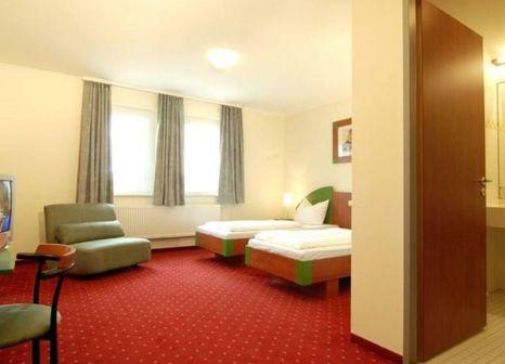 Hotelzimmer mit Mountainbike im EuroHotel Günzburg