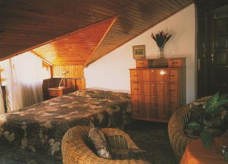 Hotelzimmer mit Clubs im Begonville Pension