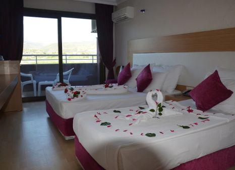 Hotelzimmer mit Mountainbike im Drita Hotel Resort & Spa