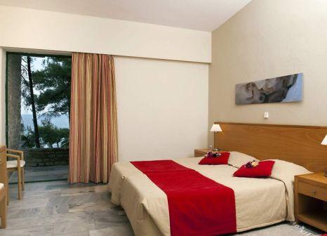 Hotelzimmer mit Tischtennis im Makryammos Bungalows