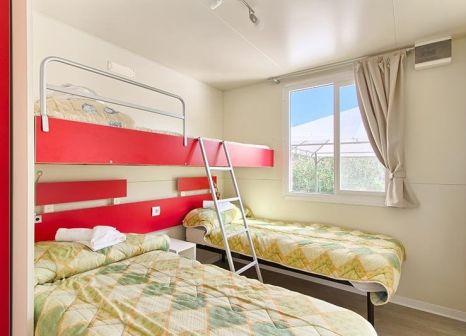Hotelzimmer mit Minigolf im Camp Oliva Mobilehomes