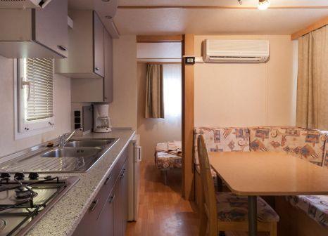 Hotelzimmer mit Mountainbike im Centro Vacanze Isuledda
