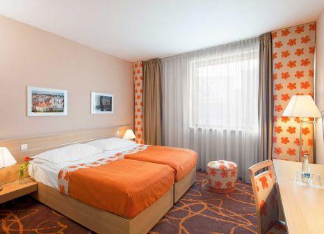 Hotelzimmer mit Mountainbike im Iris Hotel Eden