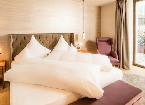 Hotelzimmer mit Ski im Castel