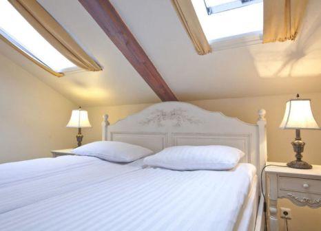 Hotelzimmer mit Hochstuhl im Fosshotel Baron