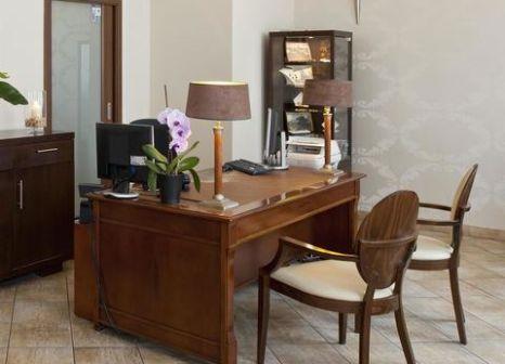Hotelzimmer mit Hochstuhl im Hotel Bonum