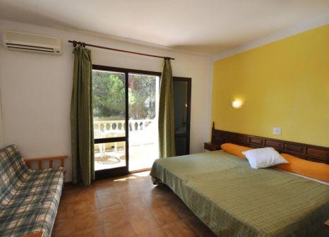 Hotelzimmer mit Mountainbike im Don Carlos Hostal