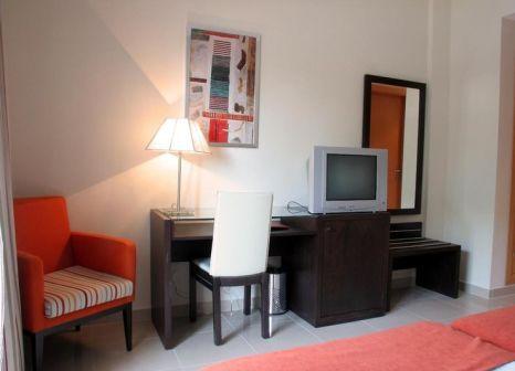 Hotelzimmer mit Mountainbike im Hotel Pradillo Conil
