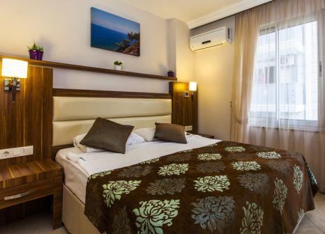 Hotelzimmer mit Mountainbike im Oba Time