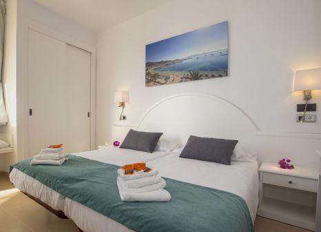 Hotelzimmer mit Mountainbike im Duva Aparthotel Conventionscenter & Spa