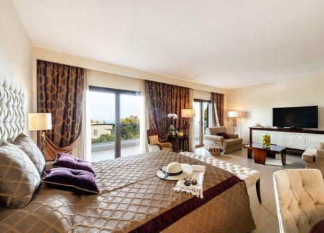 Hotelzimmer mit Mountainbike im Pomegranate Wellness Spa Hotel