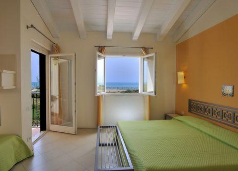 Hotelzimmer mit Mountainbike im Sikania Resort & Spa