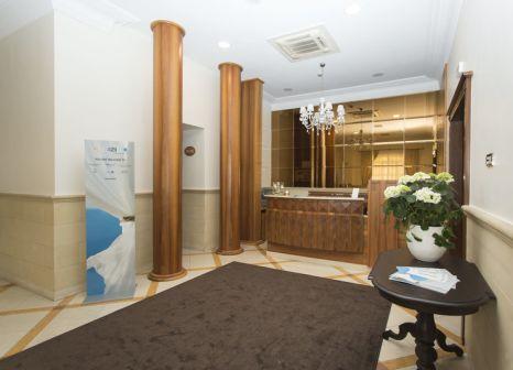 Hotelzimmer mit Hochstuhl im Cavaliere