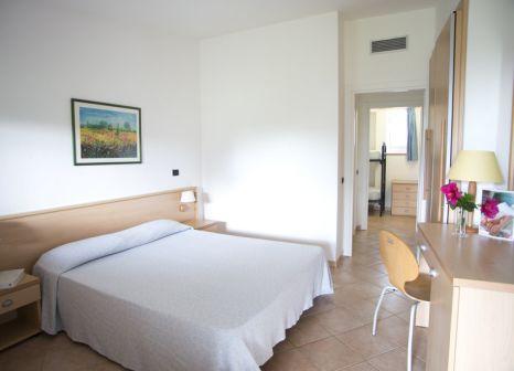 Hotelzimmer mit Mountainbike im Hotel & Residence Cormoran