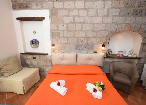 Hotelzimmer mit Mountainbike im Casale Antonietta