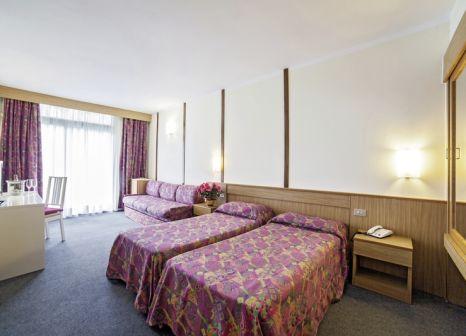Hotelzimmer mit Mountainbike im Majestic Palace