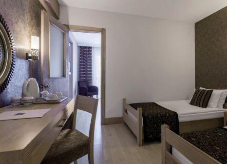 Hotelzimmer mit Mountainbike im Sultan Of Side Hotel