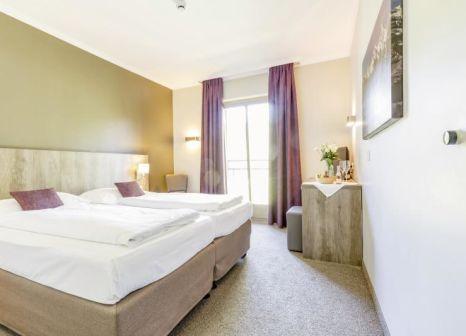 Hotelzimmer mit Volleyball im Aldiana Club Ampflwang