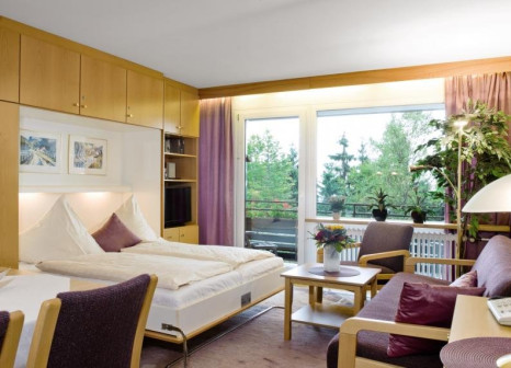 Hotelzimmer mit Mountainbike im Haus Bayerwald