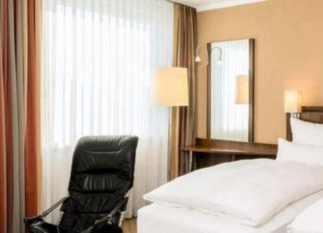 Hotelzimmer mit Hochstuhl im NH Köln Altstadt