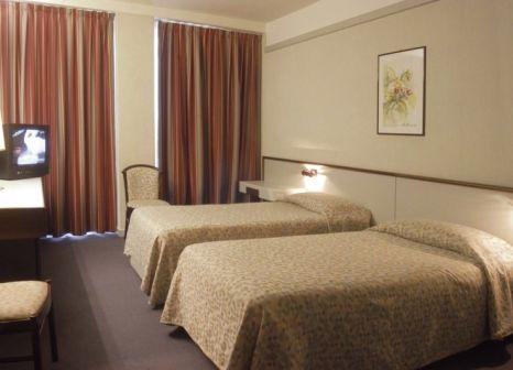 Hotelzimmer mit Ski im Maxim