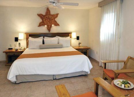 Hotelzimmer mit Mountainbike im The Reef Playacar Resort & Spa