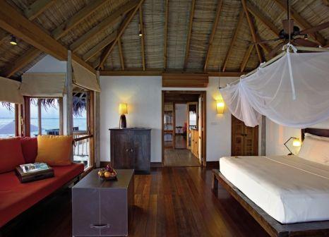Hotelzimmer mit Mountainbike im Gili Lankanfushi
