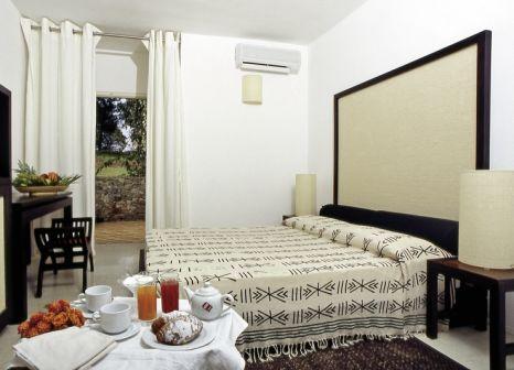 Hotelzimmer mit Mountainbike im Club Hotel Ancora