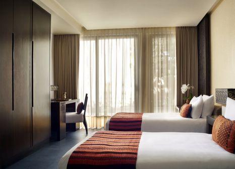 Hotelzimmer mit Mountainbike im Banyan Tree Mayakoba