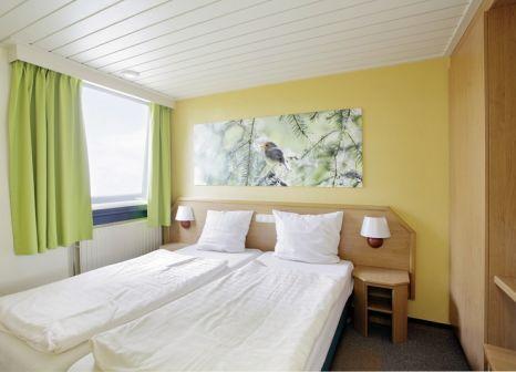 Hotelzimmer mit Mountainbike im Center Parcs De Eemhof