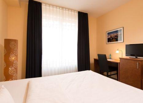 Hotelzimmer mit Pool im ACHAT Plaza Hamburg/Buchholz
