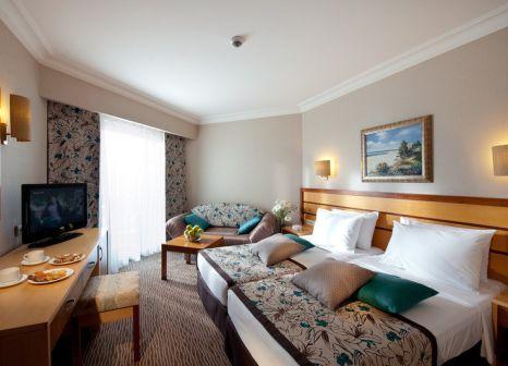 Hotelzimmer mit Mountainbike im Sun Club Side