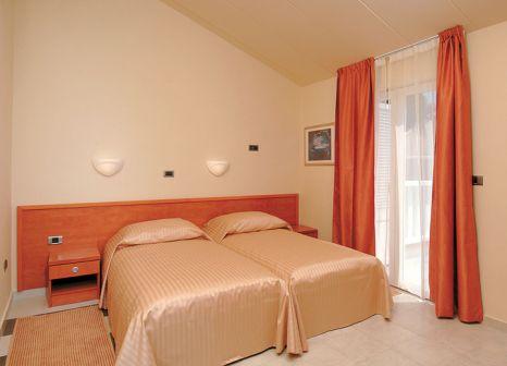 Hotelzimmer mit Mountainbike im Resort Amarin