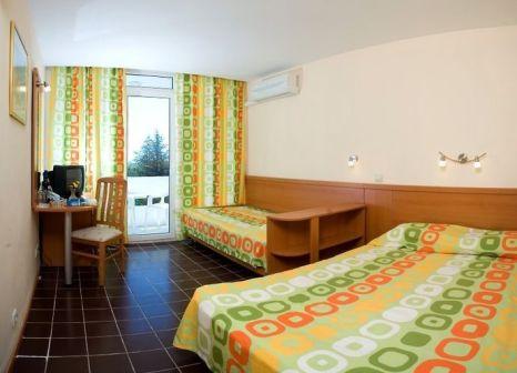 Hotelzimmer mit Mountainbike im Kompas